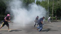 PROTESTERS RIOT POLICE TEAR GAS Stock Footage