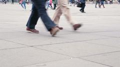 Colorful busy pedestrian foot traffic in Alexanderplatz, Berlin, Germany Stock Footage