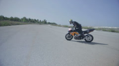 Motorcycle extreme stunt rider drifts around Stock Footage