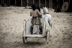 roman chariot in a fight of gladiators, bloody circus - stock photo