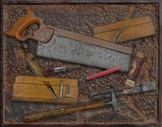 vintage woodworking tools over rusty plate - stock photo