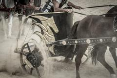 strong, roman chariot in a fight of gladiators, bloody circus - stock photo
