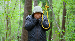 Man with noose in the  woods episode 2 Stock Footage