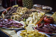Mediterranean food plates, european cuisine, medieval fair in spain Stock Photos