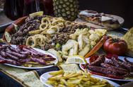 Stock Photo of mediterranean food plates, european cuisine, medieval fair in spain