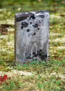 Weathered Headstone - stock photo