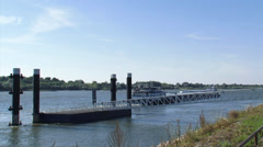Rhine barge departs from pier and car rides up to the  car dock pier Stock Footage