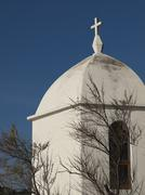 Small white chapel by a tree with blue sky Stock Photos