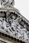 Stock Photo of mythology, national library facade in madrid, spain