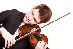 Mies viulisti soittaa viulua. klassisen musiikin art Kuvituskuvat