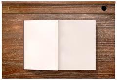 vintage school desk top with open blank book - stock illustration