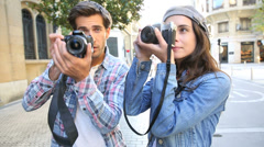 Young photographers taking pictures in town Stock Footage