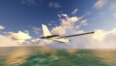 Small plane flying over the sea Stock Footage
