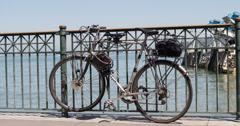 Bike locked to railing on pier sidewalk 4k Stock Footage