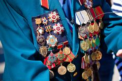 military medals on the jacket of veteran - stock photo
