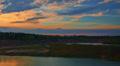 Summer sunset over forest lake landscape, time-lapse. Footage