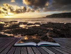 book concept beautiful seascape at sunset with dramatic clouds landscape imag - stock illustration