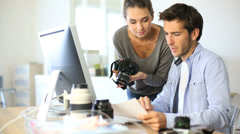 Photo reporters working in office Stock Footage