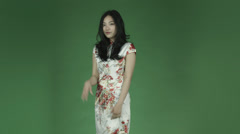 Young asian adult woman isolated on green-screen background traditional chinese Stock Footage