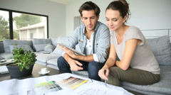 Couple searching ideas to decorate new home Stock Footage