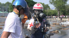 PROTESTERS RIOT POLICE TEAR GAS Paramedic Stock Footage