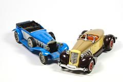 Two vintage toy model cars on white Stock Photos