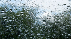 Rain on car windscreen Stock Footage