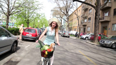 Pretty blonde girl riding bike on the street - stock footage