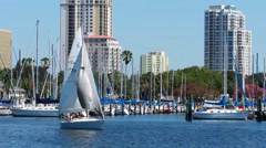 Family on a sailboat with downtown St. Petersburg skyline in background - stock footage