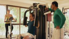 4of12 People in resort exercising in gym facility, fitness club Stock Footage