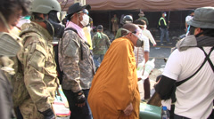 PROTESTERS RIOT POLICE TEAR GAS MONK Stock Footage