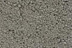 Grey bumpy concrete texture Stock Photos