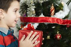 Stock Photo of Happy child receive the gift of Christmas