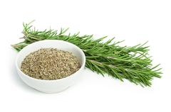 Fresh rosemary and a bowl with dried Stock Photos