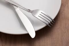 Fork and knife for dining - stock photo