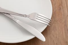 Dining table with fork and knife - stock photo