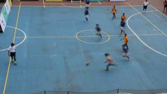 Youth participating on the neighborhood sports futsal Stock Footage
