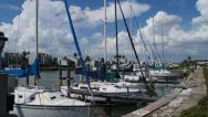 Stock Video Footage of Sail Boats Docked At A Marina With Fluffy Clouds In The Sky Ultra HD Time Lapse