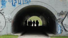 Teenagers in graffiti tunnel under Don Valley Parkway. Stock Footage
