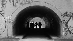 Teenagers in graffiti tunnel under Don Valley Parkway. Black & white. Stock Footage