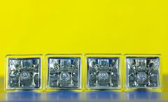 decorative electric bulb in a row 1 - stock photo