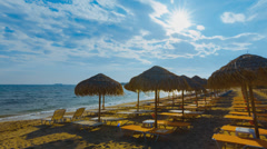 4K summer timelapse background sky sun beach umbrellas 2 Stock Footage