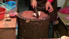 Cutting meat in asia market, Katmandu, Nepal Stock Footage