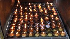 Buddhist candle fire in Katmandu, Nepal Stock Footage