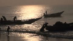 Fishermens and boats silhouette  in Bengal bay, Tamilnadu,India Stock Footage