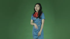 Air hostess young isolated on green-screen background with a secret Stock Footage