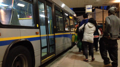 People line up for waiting bus Stock Footage