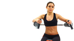 Brunette woman on hydraulic exerciser Stock Footage