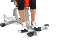 Fragment of young woman on hydraulic exerciser Stock Footage