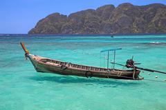 thai island. longtail boat - stock photo